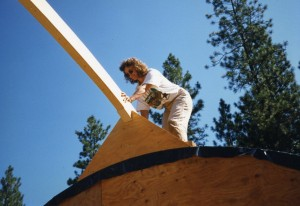 Cheryl helps raise the roof beams.