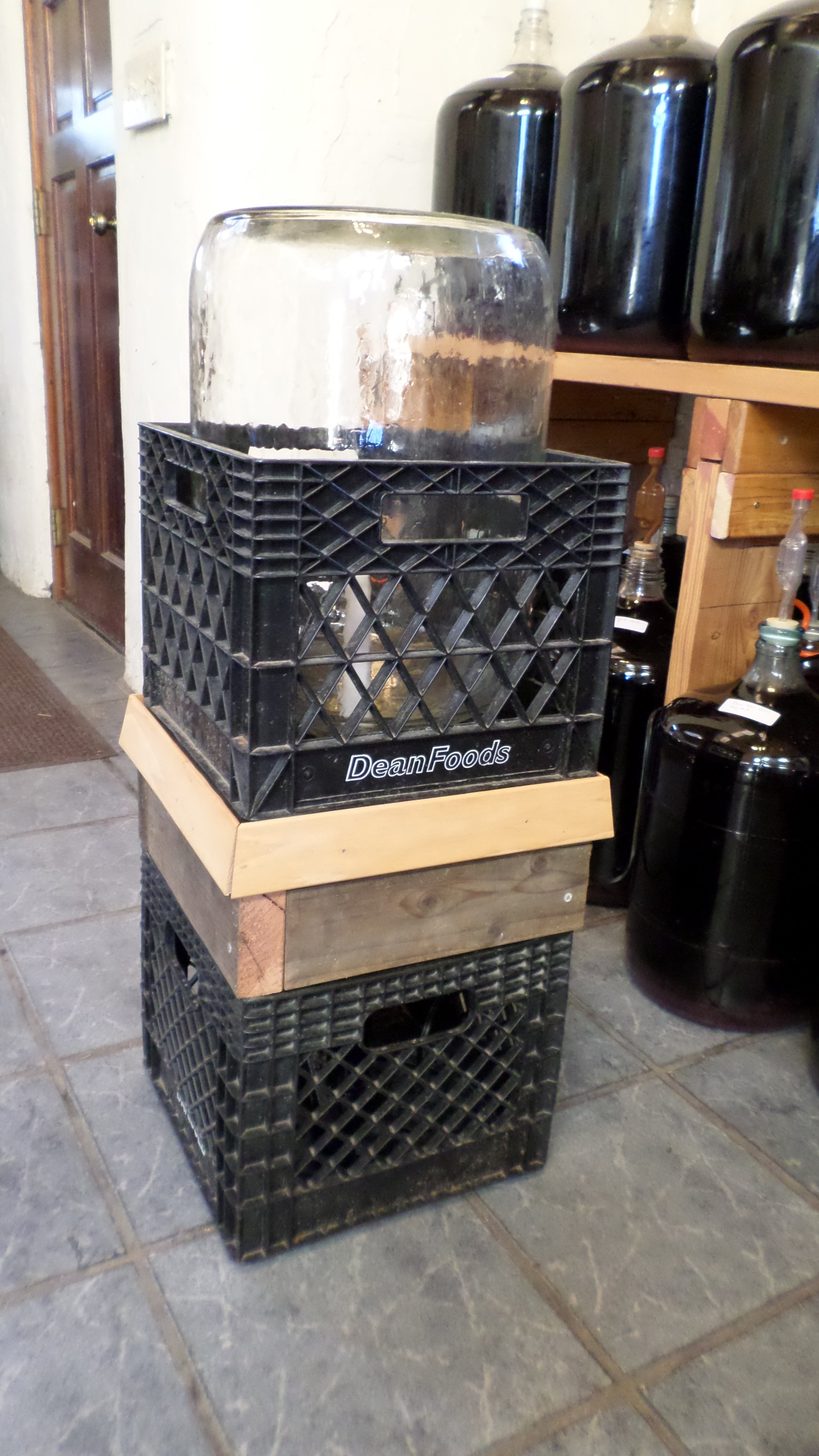 65 Gallon Carboy Drying In Crates Separated By An Insert