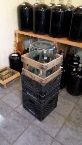 5 gallon carboy in wooden cage within the upper milk crate. No insert needed.